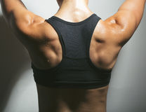 Wet back. Sweat of an athletic woman Royalty Free Stock Image
