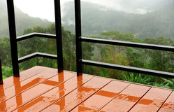 Wet balcony. Behind the valley fog Stock Photos