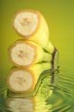 Wet Banana #2. Banana, water and mirror surface Royalty Free Stock Image