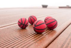 Wet five red basketballs on the street stock photography