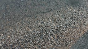 Wet beach sand, close-up stock footage