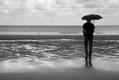 Wet beach walk. In black and white Stock Images