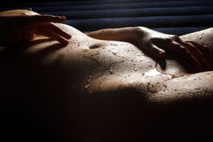 Wet beautiful naked body Stock Photography
