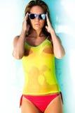 Wet beauty. Young woman in bikini and wet T-shirt Stock Photos