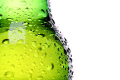 Wet beer bottle abstract. Wet beer bottle macro abstract isolated on white Royalty Free Stock Photos
