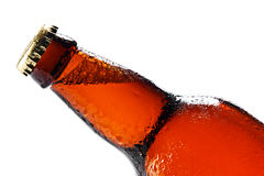 Wet beer bottle isolated on white Royalty Free Stock Photo