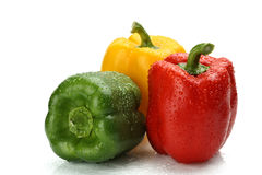Wet bell peppers. On white background Royalty Free Stock Images