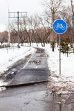Wet bicycle path in city in bad weather. In early spring season Royalty Free Stock Images