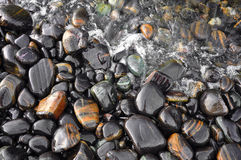 The wet black stone. Sea stones on the beach as background.Tarutao National Park,Thailand Royalty Free Stock Photos