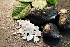 Wet black stones and sea salt Stock Photo