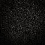 Wet black tarpaulin Stock Photography