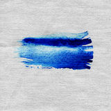 Wet blue brush stroke on fabric texture. Blue watercolor brush strokes with space for your own text. Wet brush stroke on fabric texture. Dry brush strokes Stock Photo