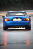 Wet Blue car. Mazda Miata Stock Image