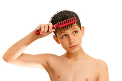 Wet boy brushes his hair Stock Images