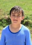 Wet boy. Little boy - smiling kid in wet blue t-shirt Stock Photos