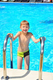 Wet boy in pool Royalty Free Stock Images