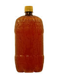 Wet brown plastic bottle with cool liquid taken closeup.Isolated Stock Photos