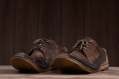 Wet brown suede shoes with brown laces. Stock Image