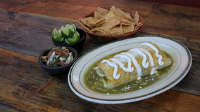 Wet burrito and salsa green verde salsa Royalty Free Stock Images