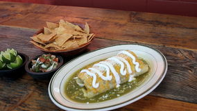 Wet burrito and salsa green verde salsa Royalty Free Stock Image