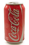 Wet Can of Coca Cola. A shiny red can on coke or coca cola with a silver pop top covered with water droplets
