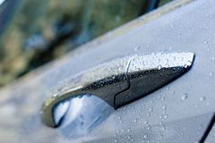 Wet car door Stock Images