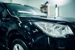 Wet car, paint protection film installation Royalty Free Stock Photo