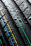Wet car tire - thread pattern closeup Royalty Free Stock Photos