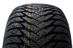 Wet car tire on white Stock Photography