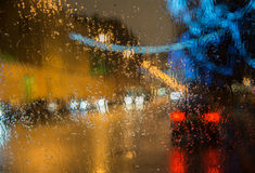 Wet  cars window with background of the night city Stock Image