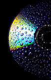 Wet CD. Water drops on a cd Royalty Free Stock Photos
