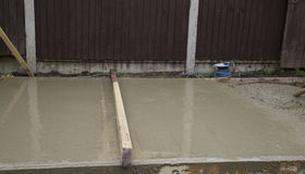 Wet cement shed base Royalty Free Stock Image