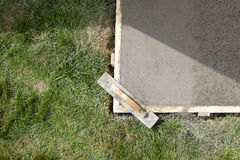 Wet cement slab form work and finishing screed Royalty Free Stock Images
