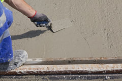 Wet cement worker Stock Photography