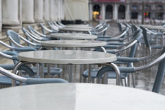 Wet chairs on San Marco. Cafe on San Marco square after rain Royalty Free Stock Photography