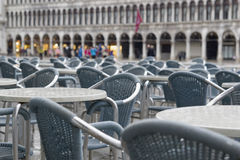 Wet chairs on San Marco. Cafe on San Marco square after rain Stock Image