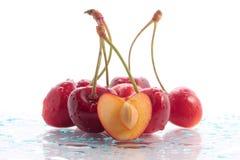 Wet cherries. Juicy, red cherries in drops of water Royalty Free Stock Photos