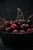 Wet cherries in bowl Stock Images