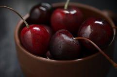 Wet cherries in bowl Stock Photos