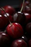 Wet cherries close-up Stock Photos