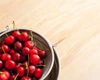 Wet cherries in stainer Stock Image