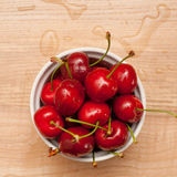 Wet cherries in white bowl Stock Image