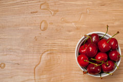 Wet cherries in wlite bowl Stock Images