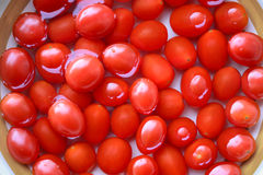 Wet cherry tomatoes Stock Photo