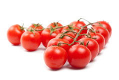 Wet Cherry tomatoes on white Stock Photo