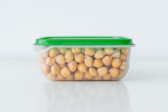 Wet chickpeas in the plastic container Stock Image