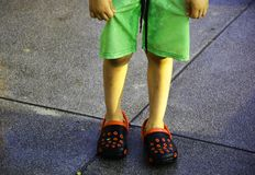 Wet chil standing on the cement floor. Child with his wet swimming clohtes is standing on the cement floor royalty free stock photo