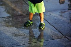 Wet chil standing on the cement floor stock images