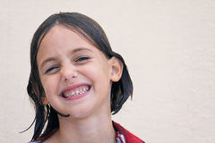 Wet child with cheesy grin Stock Images
