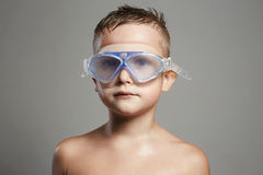 Wet child in swimming goggles Stock Photo